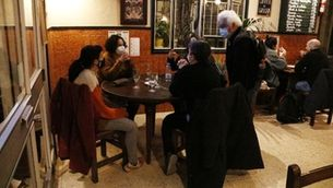 Customer enjoying a drink in Casa Pagès in Barcelona's Gràcia neighborhood