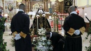Three members of the Brotherhood of the Sagrada Familia and Saint Christopher