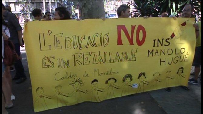 Una de les pancartes en la manifestació d'aquest dimecres a la plaça de Sant Jaume