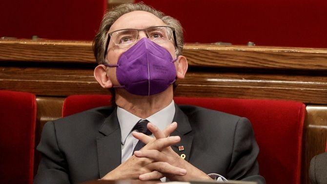 El conseller Jaume Giró, assegut a l'escó del Parlament aquest dimecres