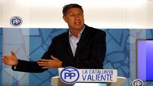El president del PP català, Xavier García Albiol, estén els braços en la roda de premsa a la seu del partit a Cataluna, aquest dilluns 8 de maig (HORITZONTAL)
