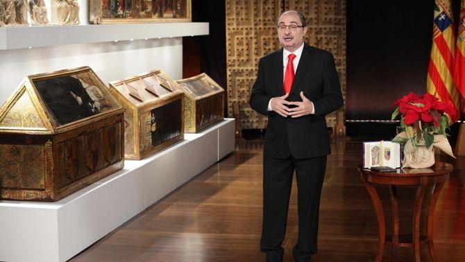 Discurs de cap d'any del president d'Aragó, Javier Lambán, des del monestir de Sixena, amb diverses obres exposades, al fons